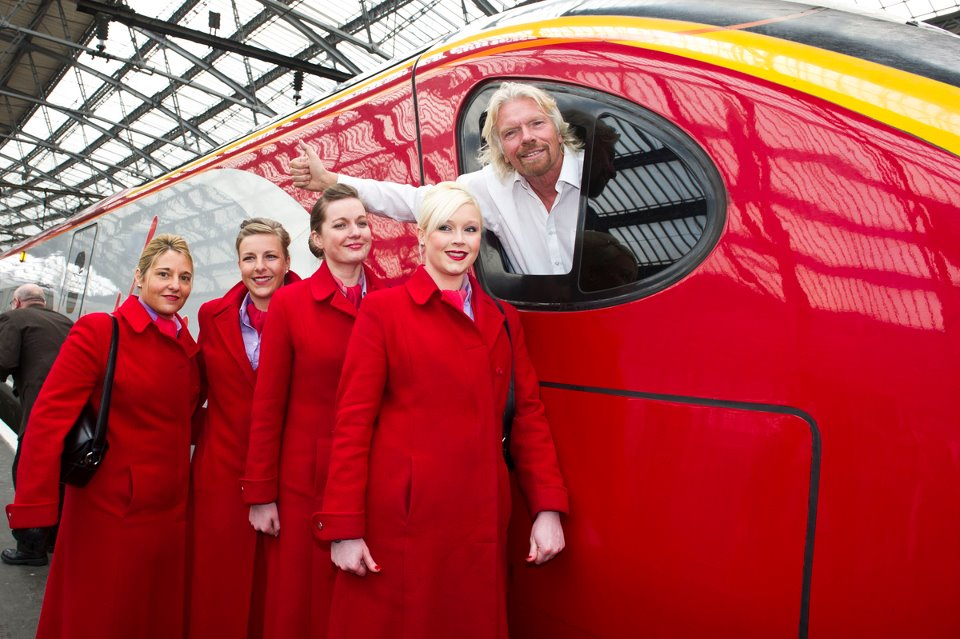 Sir Richard Branson er grundern av Virginselskapene, og Virgin Trains. Han er Man U-fan, men ønsker deg velkommen ombord også om du vil til andre fotballbyer!